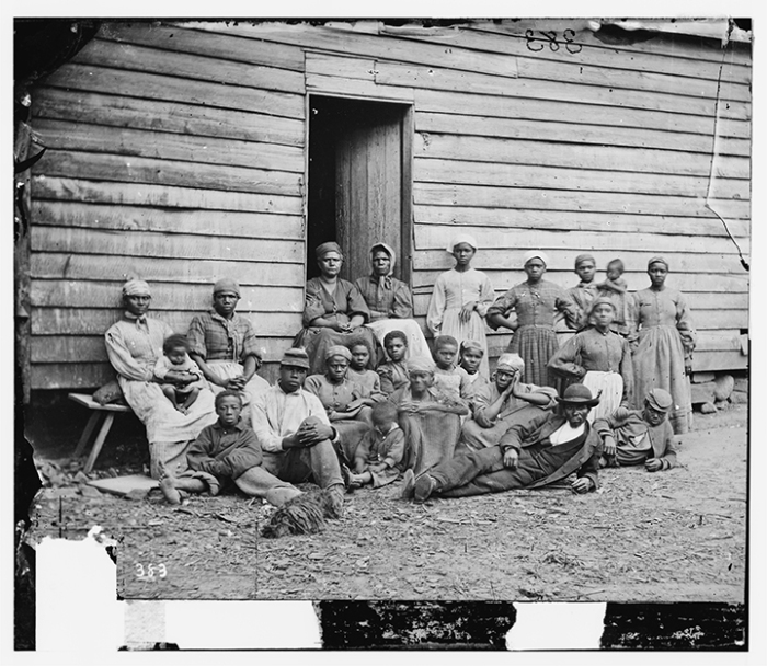 """Cumberland Landing, Va. Group of ""contrabands"" at Foller's house,"" May 14, 1862, Photo by James F. Gibson, from the Library of Congress"