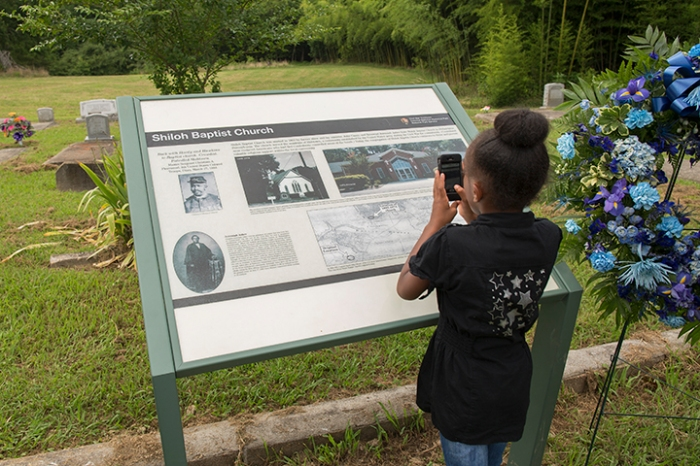 Young lady photographs newly installed wayside at the old Shiloh Baptist Church Cemetery, Yorktown, VA,  July 23, 2013