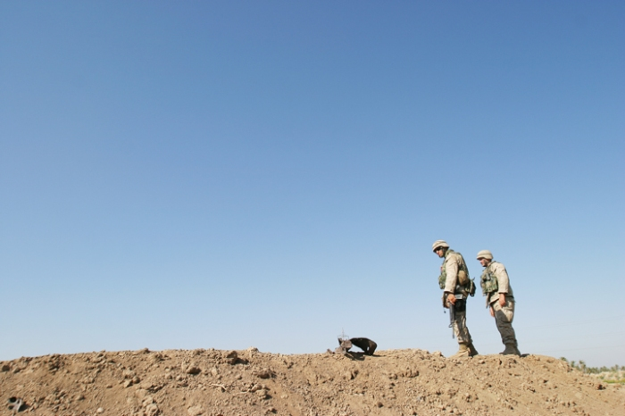 Marines from 1/2 Bravo Co., 2nd Platoon, checking for IEDs during a routine patrol, Babil Province, Iraq, August 20, 2004