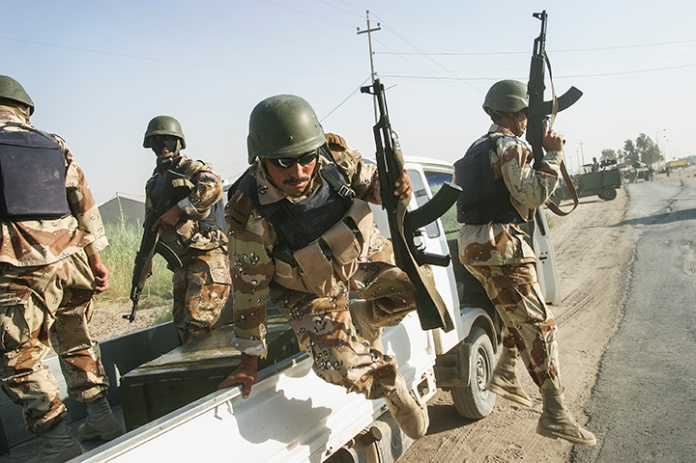 Iraqi troops on joint patrol with U.S. marines, Iskandariyah, Iraq, August 5, 2004